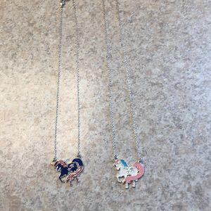 Set of two unicorn necklaces.